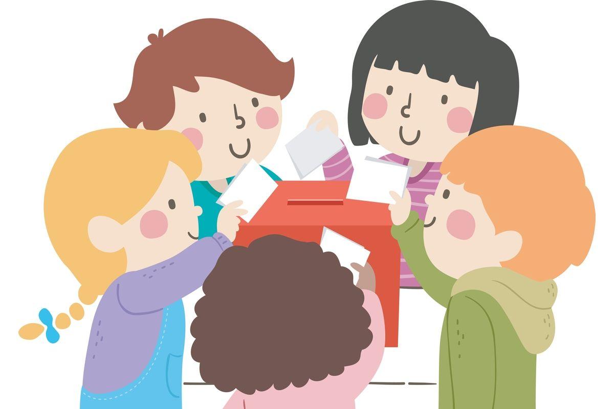 Dzieci wrzucające głosy do urny