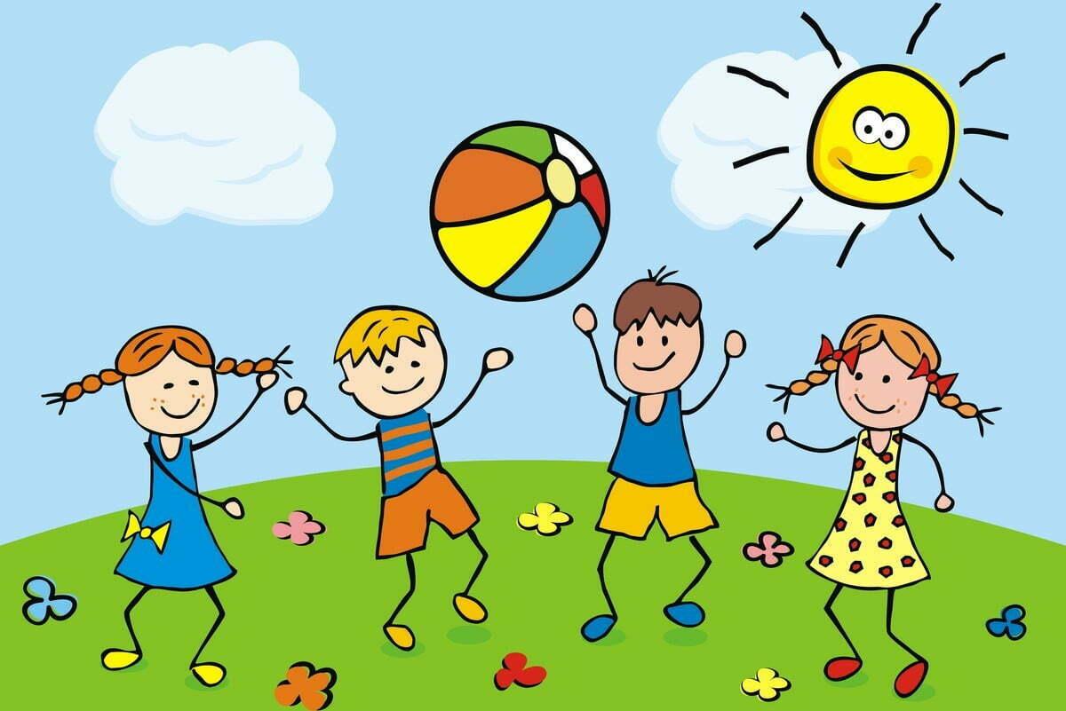 Dzieci grające w piłkę na łące
